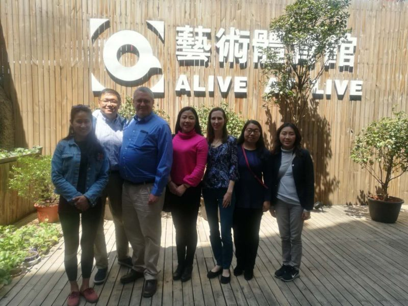 Pictured are US Fellows David Moore and Marion Batayte, Chinese Fellows Li Jie and Liu Chunhua and staff from the Kunming office of Save the Children.